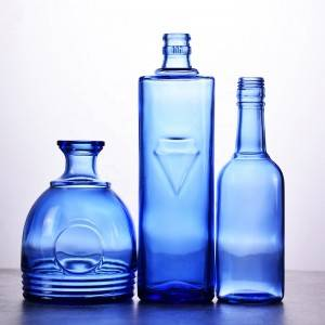 Unique shaped empty blue wine glass bottle