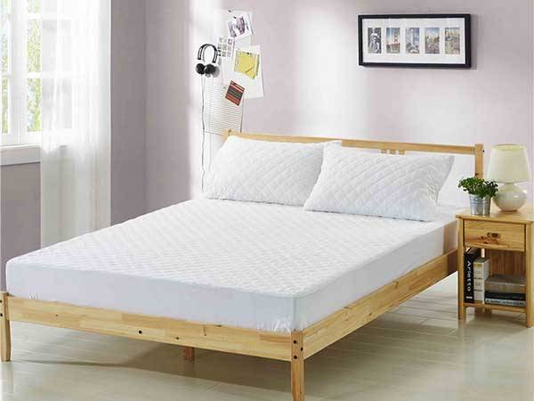 What does a mattress protector do?