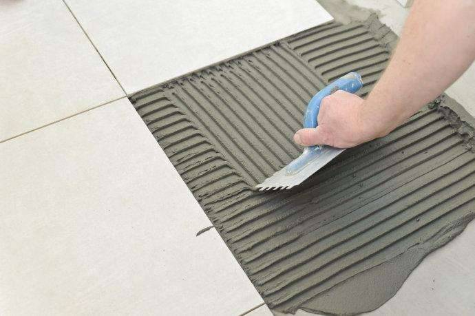 Tile laying systems
