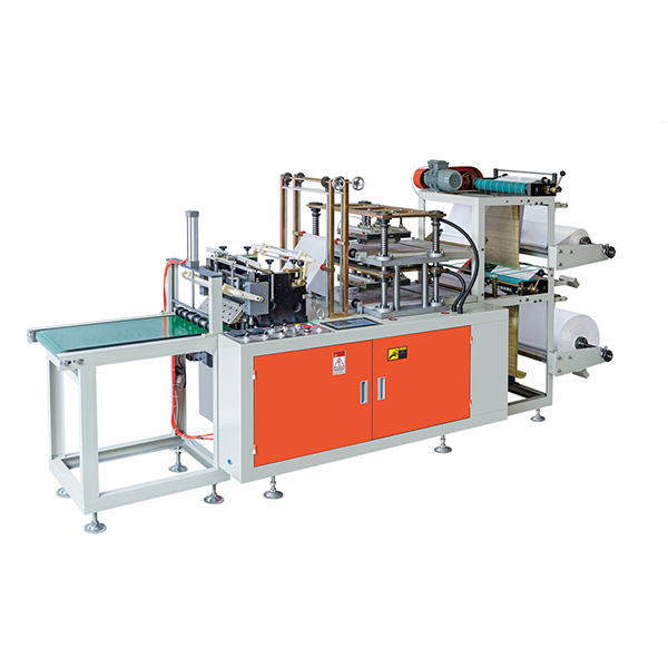 Glove making machine