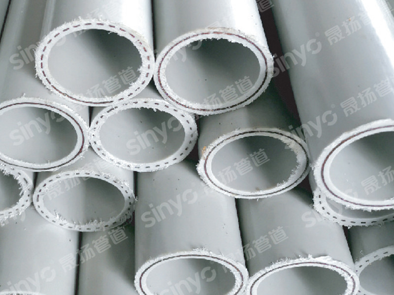 Heat-resistant polyethylene composite pipe with perforated steel mesh