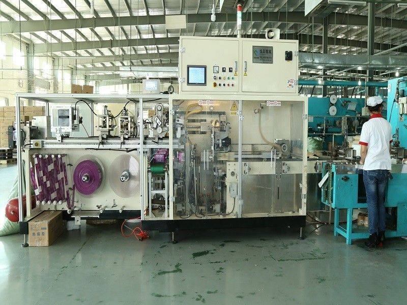 Sanitary Pad Machine / Full servo sanitary napkin bag making on line 60 bags/min Speed Featured Image
