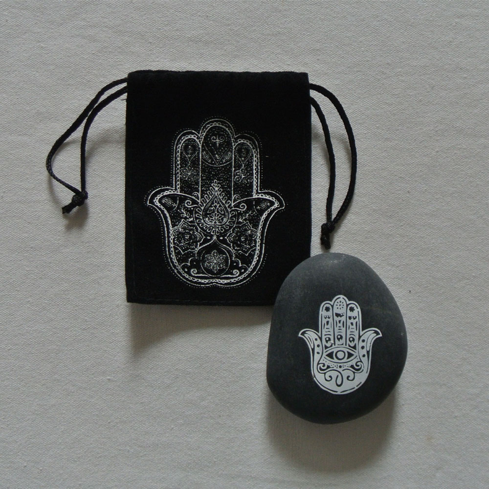 natural pebble stone with customized printing designs of hamsa hand black pebbles polish stone Featured Image