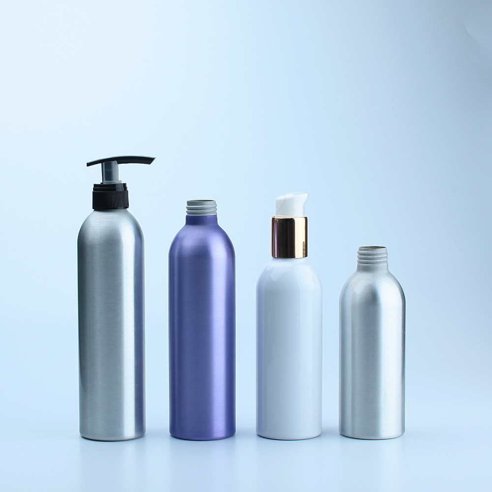 Empty shampoo and conditioner bottles with lotion pump