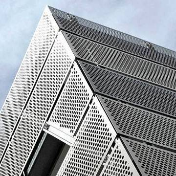 Perforated Metal Cladding Keeps the Building from Weather Damage Featured Image
