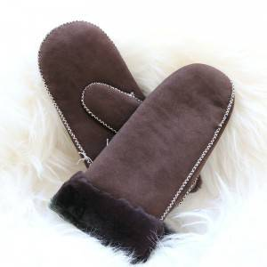 Handmade sheepskin mittens characteristic with cross stitchs