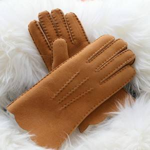 Ladies handmade merino sheep shearling gloves feature waving cuff