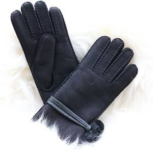 Ladies handsewn double faced shearling gloves feature leather belt