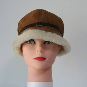ladies sheepskin cloche hats feature a leather belt