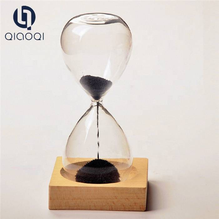 Magnetic hourglass with wooden base