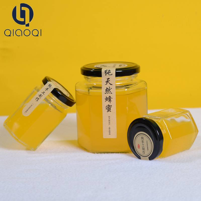 Hot sales glass customized bee honey bottle / glass jar