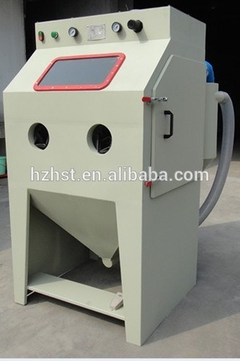 Suction abrasive sand blaster
