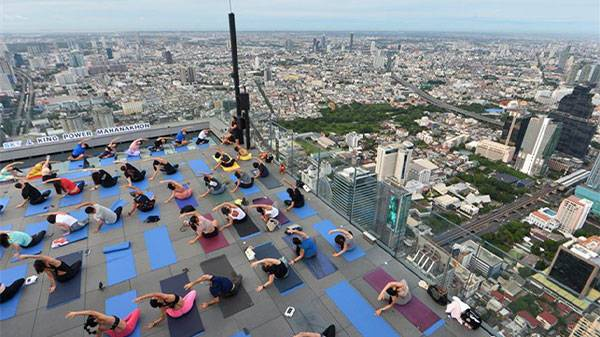 Yoga Enthusiasts Practice Yoga In Bangkok, Thailand
