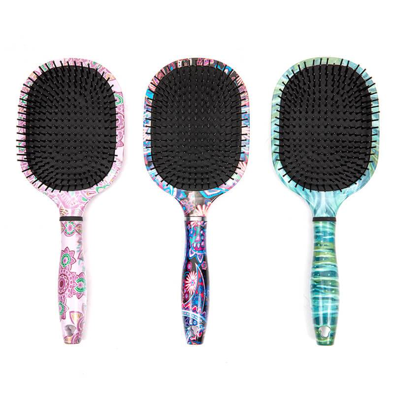 Rubber coating, water transfer, UV electric paddle hair brush with flexible cushion