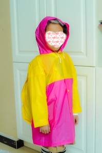 Cheap color matching plastic raincoat with backpack for children