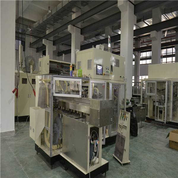 Servo Driving 380V / 50Hz 16KW Fully Automatic Sanitary Napkin Making Machine Featured Image