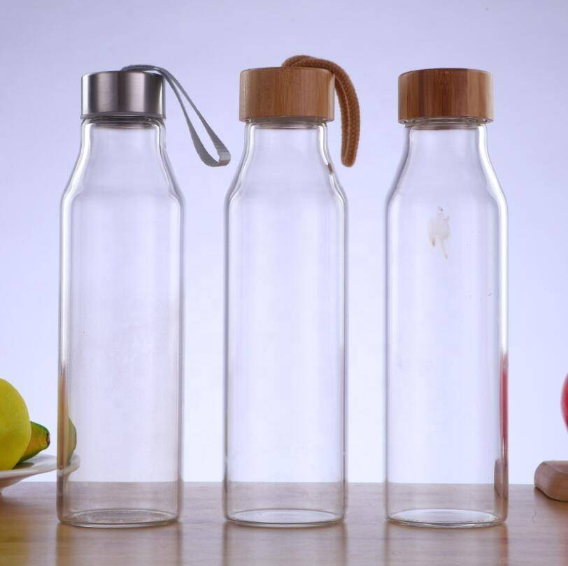 Eco friendly double wall glass drink water  bottle with bamboo steel lid