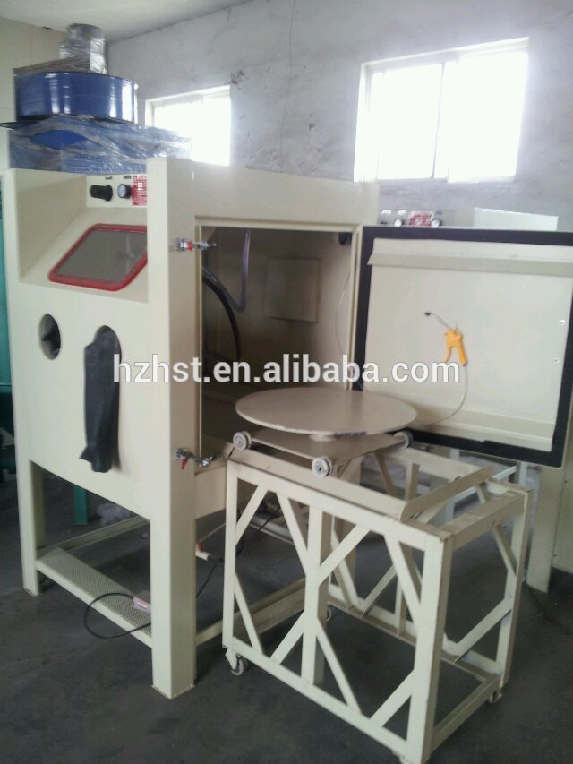 Sand blasting machine for mould stone