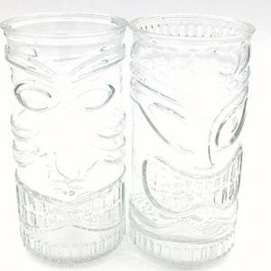 Cylindrical relief mask glass candle holder