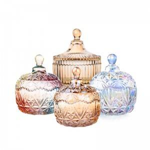 A glass candy jar of amber and clear colors for your choice in stock