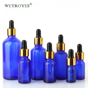 Cobalt Blue Glass Cosmetic Packaging with Gold Dropper