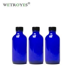 Cobalt Blue Glass Boston Round Bottle with Phenolic Cap