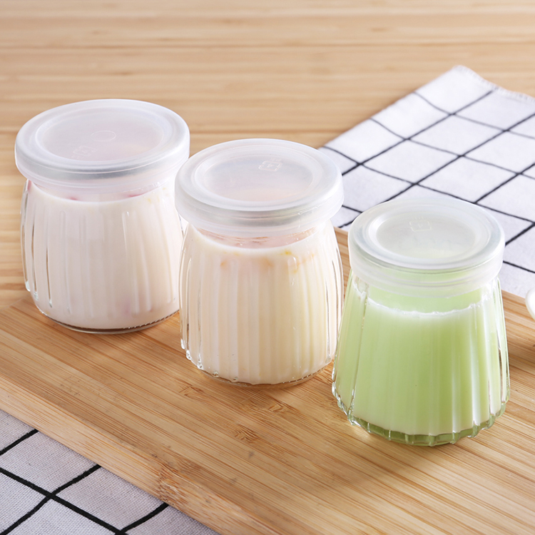Hot sale vertical grain Pudding Bottle yogurt Glass bottle with lid Featured Image